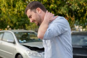 A man suffering a neck injury after a car accident
